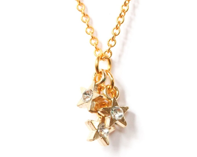 Necklace with a 60 cm golden chain and 3 small star pendants with a rhinestone