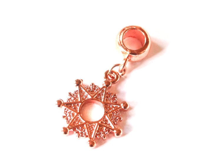 Pendant with a bright copper/rosegold star and bail