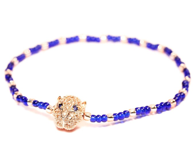 Bracelet with a rose gold panther head with zirconium, and blue Toho beads