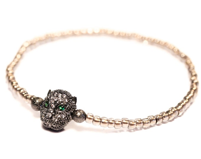 Bracelet with a gunmetal panther head with zirconium, and bronze Toho beads