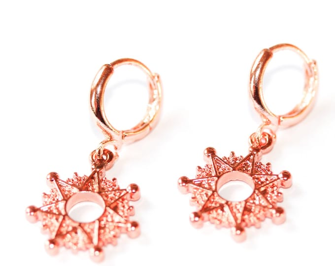Rose gold hoop earrings with copper stars