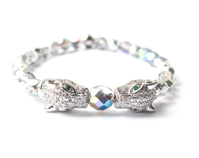Bracelet with 2 silver panther heads with zirconium, and silver rainbow faceted glass beads