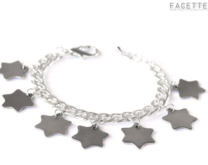 Silver bracelet with thick chain, 7 silver star charms
