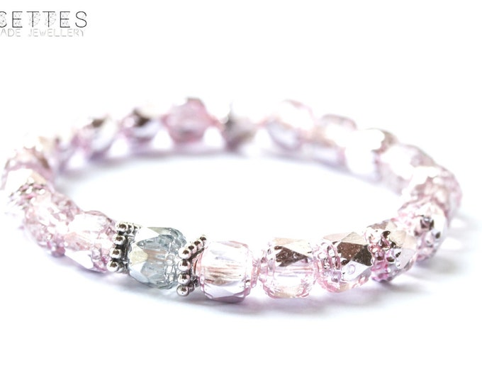 Stunning light pink bracelet with glass beads and antique silver spacers