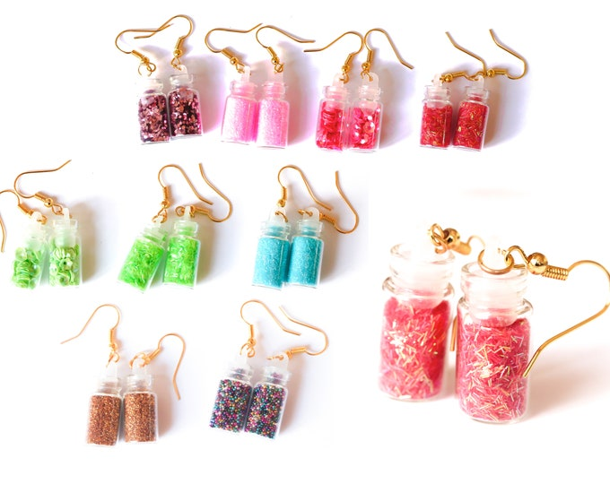 Earrings with vials containing colourful glitters