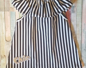 Toddlers girls ruffle tunic top in black and white stripe fabric with embroidery chic patch