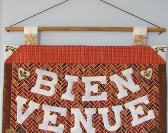 Brick house French welcome (Bienvenue) sign in patchwork