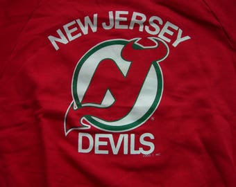 84682ee23 Vintage New Jersey Devils NHL hockey red sweatshirt by LOGO7 made in the  USA New with tags