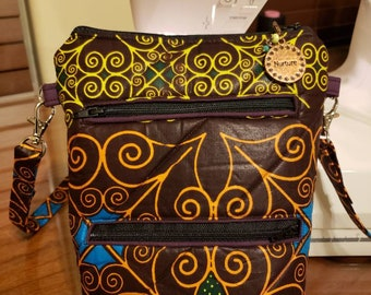 Beautiful African Inspired Multi Colored Crossbody Bag - Fully lined, quilted with 2 exterior zippered pockets as well as 1 inner pocket.