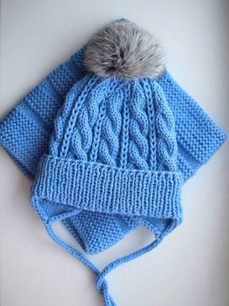 5e5a6947729 Knitted winter hat with fur pom pom and neck warmer scarf for