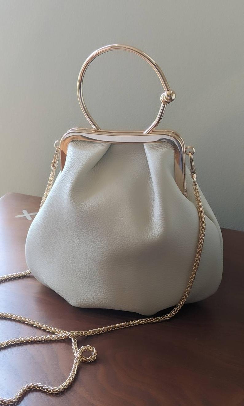 Vintage Handbags, Purses, Bags *New* Cream leather handbag leather handbag handle bag leather shoulder bag gold handle bag white leather handbag ivory handbag leather bag $158.00 AT vintagedancer.com