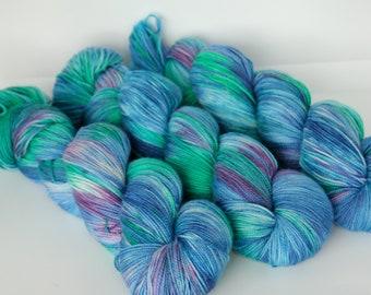Hand dyed yarn 'Feather in my Cap' sock weight yarn for knitting and crochet Rhapsodye Yarns superwash merino / nylon