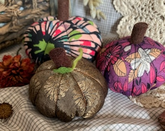 Gold, purple, patterned trio of pumpkins for autumn, fall decor, Halloween.