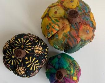 Batik, rainbow, black trio of pumpkins for autumn, fall decor, Halloween.