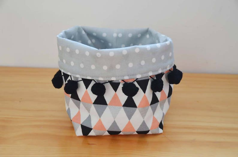 Tidy basket printed triangles and PomPoms white coral black image 0