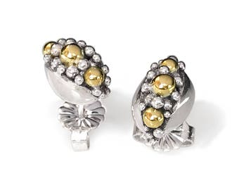 Modern designer silver and gold earrings. Great gift for woman. Anniversary, Birthday, or any occasion. Fine collectible Art jewel. Unique.