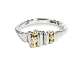 Contemporary Ring. Silver+18 kt Gold beads, very fine diamond.Artisan.Modern Designer Pamela Dickinson.Fine jewelry.Precious gift.Hallmarked