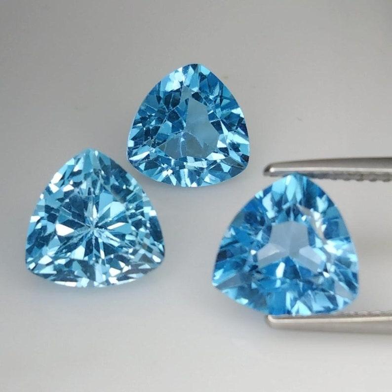 9.970 CTS  sky blue natural TOPAZ trillion cut 3pcs loose gemstones see video