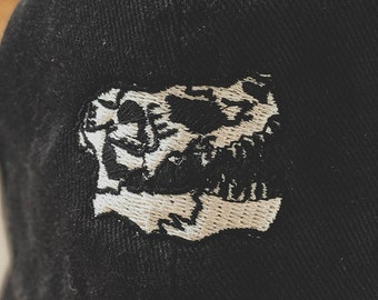 T-Rex Skull dad hat (+ free shop sticker)