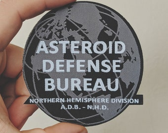 Asteroid Defense Bureau shadowy govt. patch - Iron on -