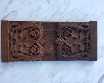 Ornate carved wood bookends
