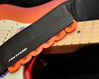 Strap mounted guitar pick holder