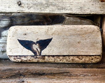 Whales Tail wood burn on driftwood from the Puget Sound of the Pacific Northwest