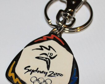 Sydney 2000 Olympic KeyChain, Olympic Games Olympic Rings Key Chain by Socog 1996 Perfection, Running athlete relaying the Olympic torch
