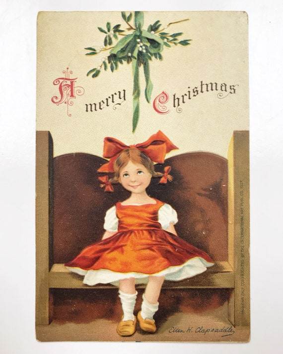 "Signed Ellen H. Clapsaddle ""A Merry Christmas"" Postcard - Girl Waiting Under the Mistletoe"