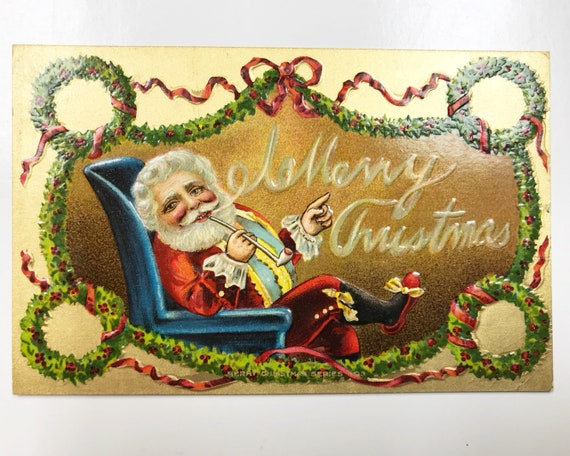 Antique Christmas Postcard - Santa Claus Smoking a Clay Pipe and Relaxing in a Chair - A.M.P. Co. Merry Christmas Series