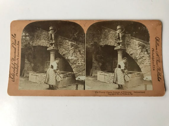 "Universal View Co. William H. Rau Stereoview ""The Pretty Cheese Scraper of Fribourg, Switzerland - Copyright  1902"