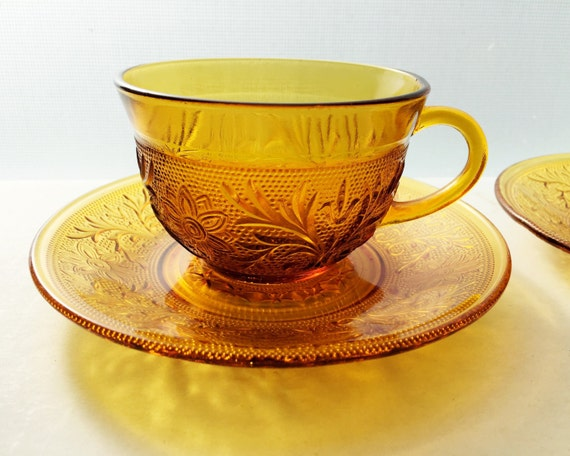 Anchor Hocking Sandwich Glass - Set of 2 Teacups and Saucers in Amber - Gorgeous Scroll and Flower Pattern - Double Sandwich