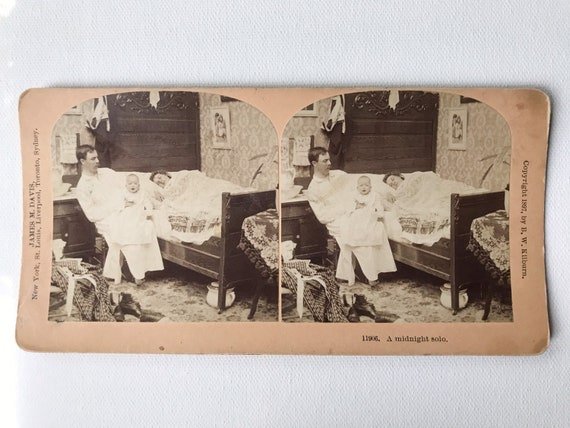Antique B. W. Kilburn Sepia Stereoview - 11906 A Midnight Solo - Father with Baby While Mother Sleeps