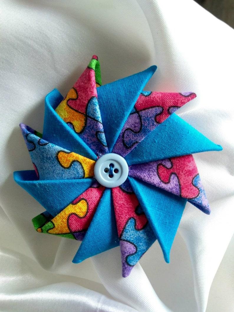 Pinwheel Fabric Pin Jigsaw Puzzle Fabric Pin Autism themed image 0