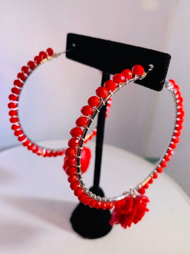 Electric red beads wire wrapped to 2.5 sterling silver lever back hoops with perfectly matched dangling red roses.
