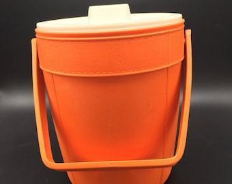 Vintage orange snowflake Rubbermaid plastic ice bucket. Retro, groovy, 1970s