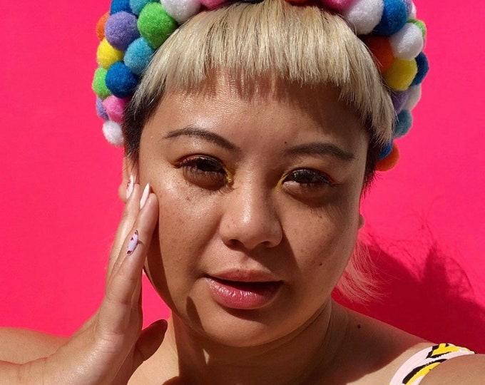 The Meg, mega Pom Pom party headband