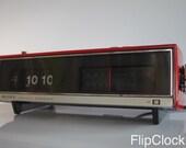 Classic 1972 Sony firy-red flip-radio-alarm-clock, the Beast from the Far East TFM-C590W