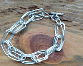 Handmade sterling silver bracelet,various sized oval loops,toggle and bar closure free UK shipping