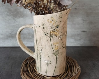 Ceramic jug with a print of herbs.pottery in the interior.Ceramics And Pottery.