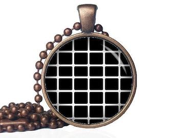 Hypnotic pendant etsy chessboard necklace hypnotic pendant optical illusion illusion necklace trance jewelry illusion mozeypictures Choice Image