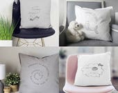 Pillows with texts in spa...