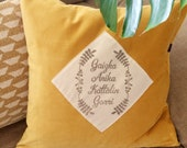 Luxury velvet pillow with nostalgic graphic application of Family names hand printed