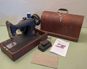 Singer Sewing Machine Model 99 in bentwood case