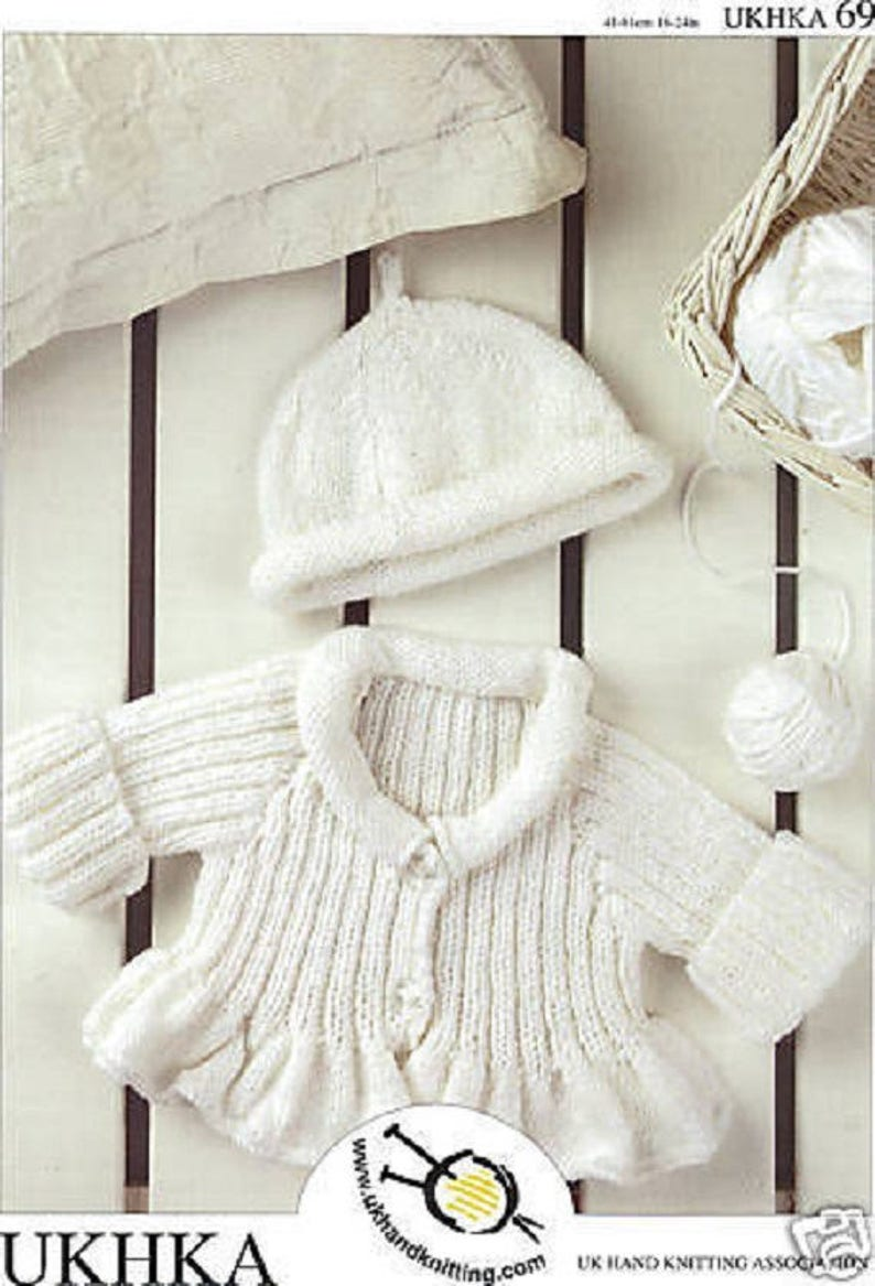 98e8be022 Baby Girls Ribbed and Flared Cardigan and hat Knitting Pattern