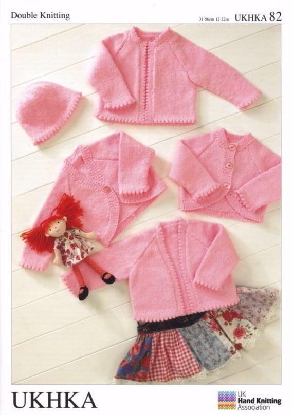 UKHKA 195 Baby Cardigans and Hat Knitting Pattern