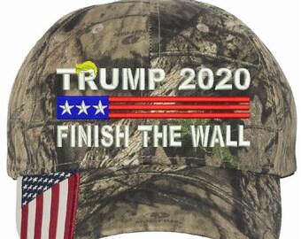 ab325563a55dc Trump 2020 Finish the Wall USA Camo Adjustable Hat with USA Side Brim MAGA