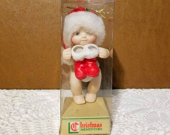 Vintage Roebuck and Co baby ornament sold by Sears, 1986 Baby holding santa's Boots ornament, Christmas tree decor, Christmas Mementoes