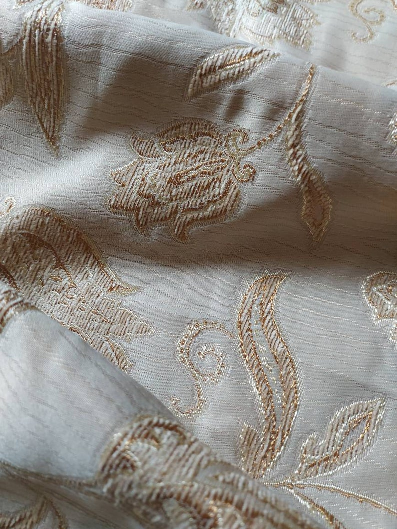 Lovely soft grey fabric with stylized flowers embossed and edged in pale brown and grey home decor fabric ships worldwide