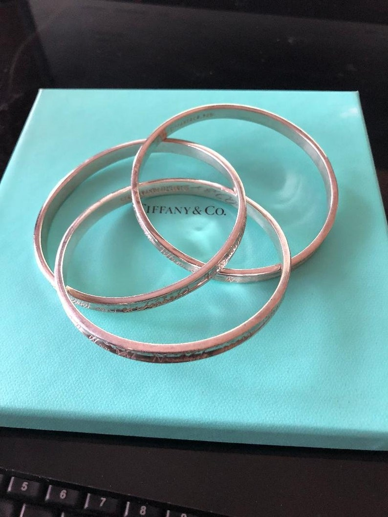 a97902cc10e41 DO NOT BUY Reserved for Susan Tiffany & Co. Sterling Silver Notes Triple  Interlocking Bangles